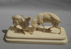 Antique ivory sculpture of stags fighting in the Rut.