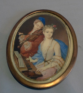 Antique miniature on ivory in gold mounted solid ivory frame.