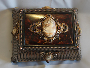 Antique silvered bronze, enamel, tortoiseshell jewellry casket with five carved