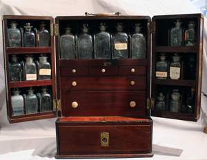Antique English apothecary or medicine chest, brass bound mahogany.