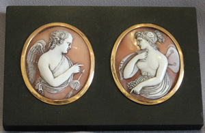 Antique English gold mounted carved shell cameos of Cupid and Psyche on English black marble base.