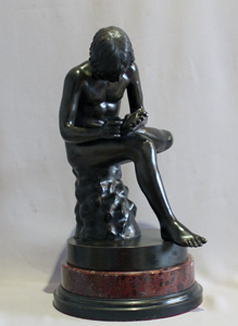 Antique Italian Grand Tour bronze of the Spinario on rouge marble base.