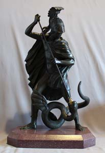Antique bronze of Jason fighting the dragon for the golden fleece.