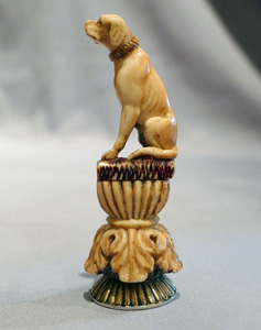 Antique seal in form of a seated dog in silver and ivory.