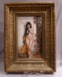 Antique continental framed porcelain plaque of naked young woman.
