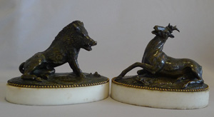 Antique pair of late 18th or early 19th century bronzes on white marble bases of boar and deer.