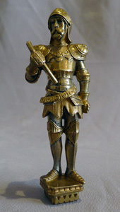Antique seal in the form of a standing knight in full armour.