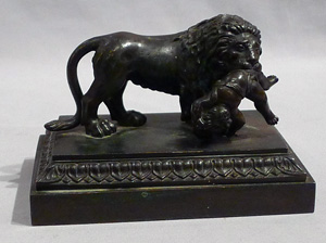 Antique English Regency bronze of Lion with child.