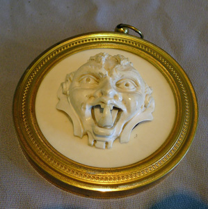 Antique French Dieppe ivory grotesque in a fine ormou frame.