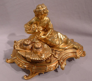 Antique gilt bronze desk standish with a reclining lady.