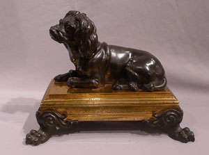 Antique French bronze of dog on ormolu base in manner of Caffieri.