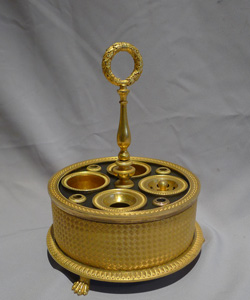 Antique French 1st Empire ormolu encrier of circular form with inkpots, pin pots and pen holders.