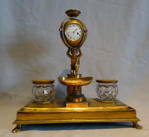 English Regency ormolu inkstand with watch movement circa 1815.