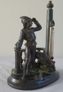 Antique patinated bronze figural thermometer of a medieval youth and his hound.