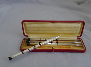 A cased set of silver and enamel Bridge Propelling pencils.