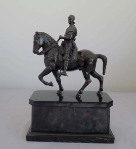 Antique bronze of Italian Rennaissance General  Bartolomeo Colleoni on his warhorse on marble stand.