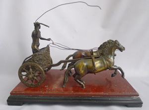 Antique Grand Tour bronze of Charioteer on rouge and black marble base