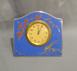 English antique silver and hand painted enamel strut clock.