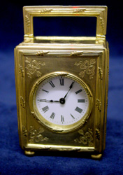 English silver gilt carriage clock by Aspreys of London.