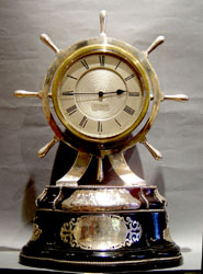 Antique English silver & ebonized ships wheel clock.