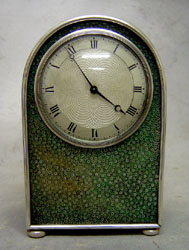 Antique English hump backed shagreen and silvered metal mantel clock probably by Jump of London.