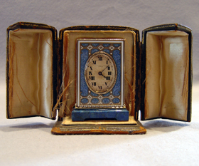 Cased  silver gilt, blue guilloche enamel, jewelled and lapis Lazuli carriage clock.