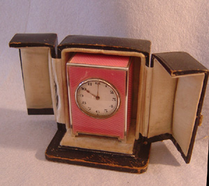 Antique Swiss silver & pink guilloche enamel boudoir clock in leather case.