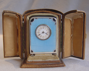 Antique sub miniature carriage clock in silver and sky blue guilloche enamel in original case.
