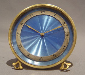A good Swiss strut clock with blue enamel dial.