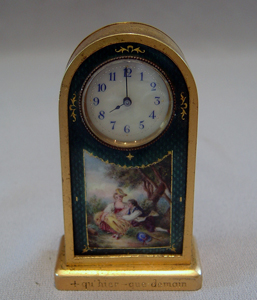 Gilt bronze and enamel miniature carriage clock.