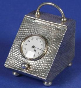 Victorian silver novelty clock in the form of a coal scuttle.