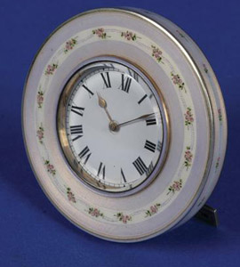 Silver and enamel paperweight clock with lavender border and roses.
