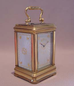 Antique carriage clock with guilloche enamel panels.