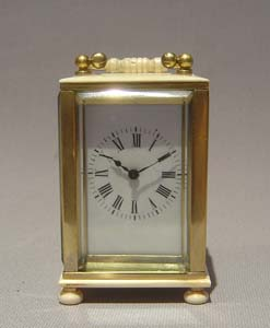 Ivory and gilt bronze carriage clock of small size.