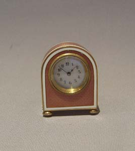 Enamel and gilt bronze sub-miniature carriage or boudoire clock.