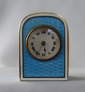 Enamel and silver gilt sub-miniature carriage clock in leather case.