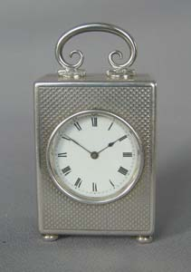 Silver engine turned small carriage clock of exceptional quality.