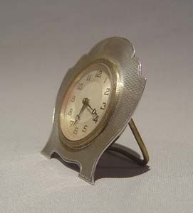Silver strut clock with engine turned shield shaped case, 1931.