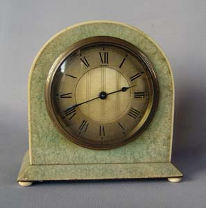 Asprey's Art deco shagreen and ivory strung dome topped mantel clock.