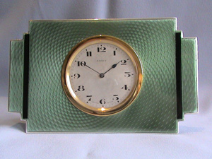 Art Deco clock in silver with green and black guilloche enamel.