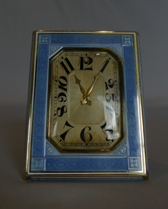 Guilloche enamel and silver, heavy strut clock.