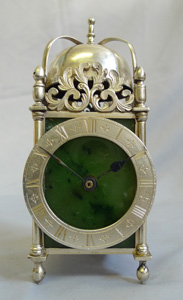 Antique Asprey solid silver and moss agate mantel clock in form of a lantern clock.