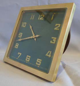 Bucherer gilt bronze and green guilloche enamel strut clock