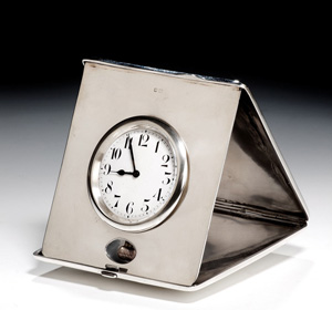 Silver travelling clock with 1/4 repeat mechanism. Hallmarked for Birmingham 1912.