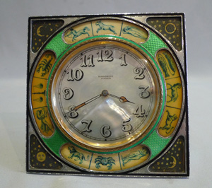 Silver, mother of pearl and enamel strut clock with decoration