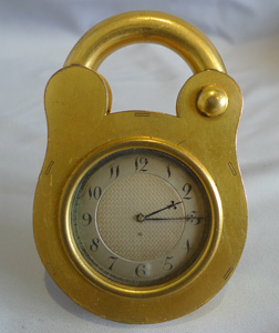 Antique padlock clock by Howell James, boxed.