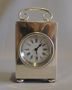 Antique English solid silver carriage clock dated 1897.Silver carriage clock