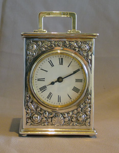 Antique English Edwardian solid silver carriage clock.