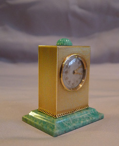 Sub miniature, cased, solid 14 carat gold jade mounted carriage clock by Geneva Clock Company.
