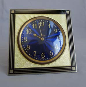 Silver and enamel strut clock with fabulous deep blue dial.
